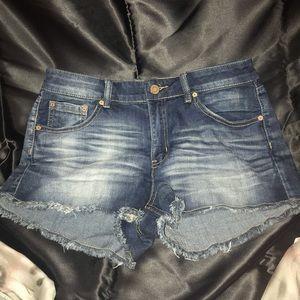 Indigo Rein Shorts. Distressed medium dark wash